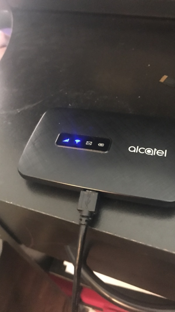 Black Alcatel Pocket Wifi brand new has not even been registered we have  password for it as well