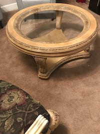 Round brown wooden framed glass top coffee table Woodbridge, 22193