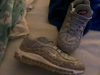 pair of gray and off-white snakeskin Nikes Westland, 48185