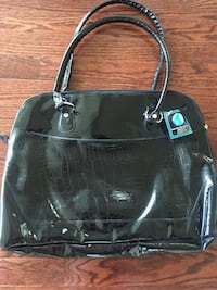 Brand New large hand bag. Can meet in  Aldie, chantilly, Centreville, Arlington. Aldie, 20105