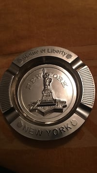Round silver color Statue of Liberty New York