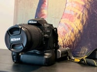 Nikon D90 DSLR Camera with 18-105 mm Lens and Grip