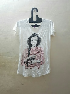 black haired woman in striped shirt-printed crewneck shirt