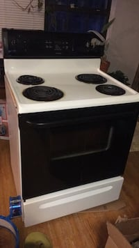 white and black electric coil range oven Evans, 30809
