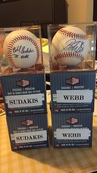 Autographed baseball balls. brand new in their original clear boxes