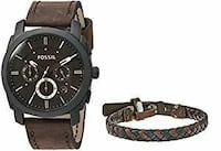 round black Fossil chronograph watch with brown leather strap