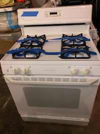 GE white gas range in excellent conditions Baltimore, 21223