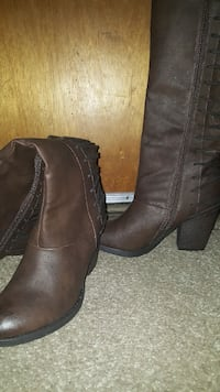 Pair of brown leather high boots