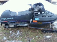 black and purple snowmobile