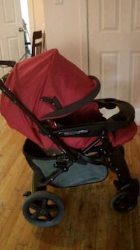 baby's red and black stroller Mississauga, L5W