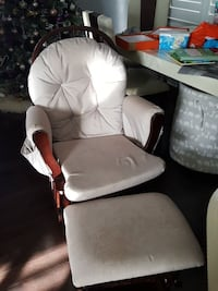 white fabric padded glider chair