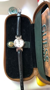 Two round silver analog watches with black leather straps Surrey, V4A 3Z7