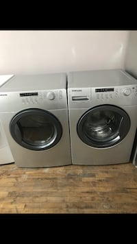 two white front-load clothes washer and dryer set Montreal, H2G 2X3