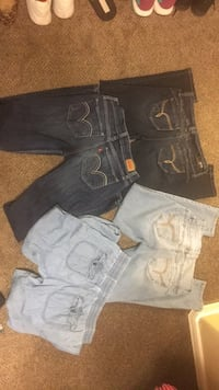three blue, gray, and black denim bottoms Las Cruces, 88012
