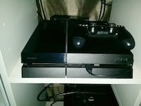 black Sony PS4 console with controller Grimsby, L3M 1P9