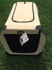 white and black pet carrier 504 km