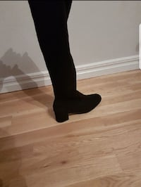 unpaired black suede boot