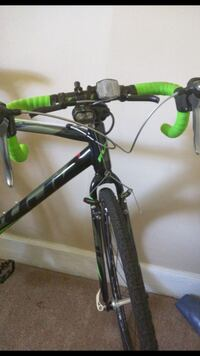 black and green road bicycle