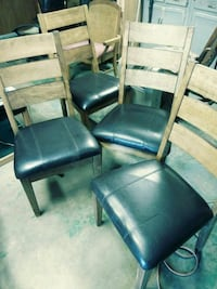 two black leather padded chairs Oklahoma City, 73122