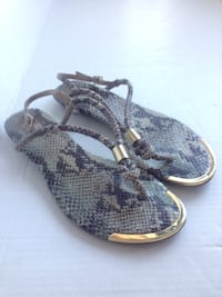 women's pair of snakeskin leather sandals