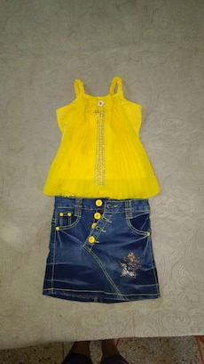 yellow dress and blue skirt