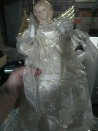 doll of angel in white dress