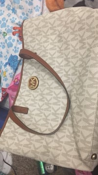 brown and white monogrammed Michael Kors leather crossbody bag Louisville, 40241
