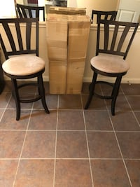 two black wooden framed gray padded chairs Houston, 77077