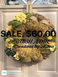 green and yellow floral wreath with text overlay Stoney Creek, L8G 1C3
