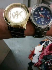 round gold-colored Michael Kors and silver-colored Wenger analog watch with link bracelets Affton, 63123