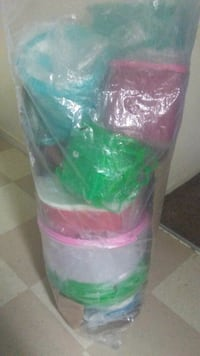 pink and green plastic container 2292 mi