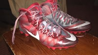 pair of red-and-gray Nike cleats