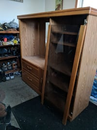 brown wooden TV hutch