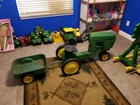 green and yellow John Deere tractor ride-on toy