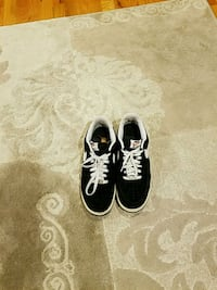 pair of black-and-white sneakers New York, 10803