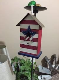 white and red wooden birdhouse