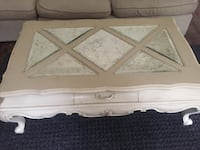 white wooden framed glass top coffee table
