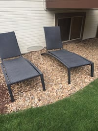 2 brown wicker chairs wrought iron with patio table