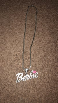 silver-colored Barbie pendant with silver chain necklace