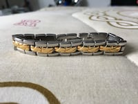 Woman's Silver and gold-colored link bracelet Toronto, M8V 3Y7