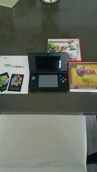 black Nintendo 3DS with game cases Vista, 92083