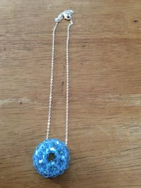 Blue gemstone pendant silver chain link necklace