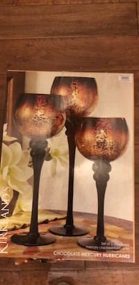 two brown and red candle holders 2272 mi