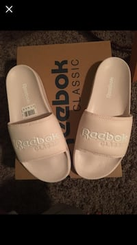 pair of white leather slide sandals Airdrie, T4B 0E3