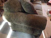 brown corduroy sofa chair with throw pillow Calgary, T3A 6A5