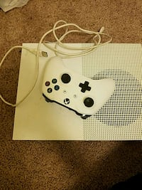 white Xbox One console with controller 162 mi