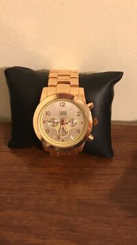 Silver round chronograph watch with silver chain strap