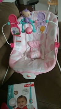 baby's white and pink Fisher-Price bouncer Frederick, 21703