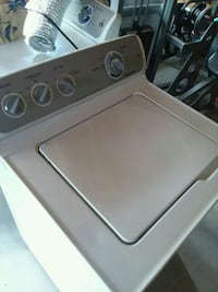 white top-load clothes washer 233 km