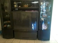 brown wooden TV hutch with flat screen television Bakersfield, 93307